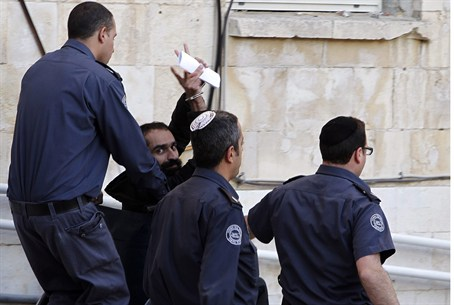 Samer Issawi gestures as he leaves the Jerusa