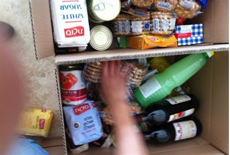 Pesach food packages being prepared by volunt