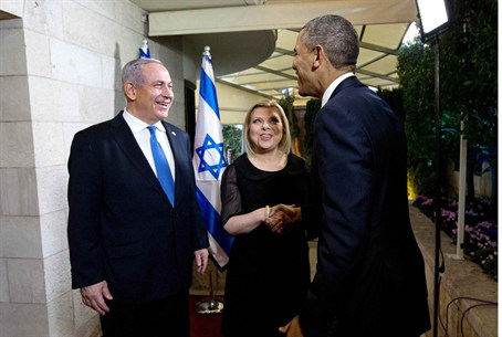 Obama is greeted by Prime Minister Netanyahu