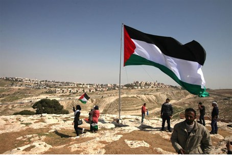 PA Arabs hoist a PLO flag close to Maale Adum