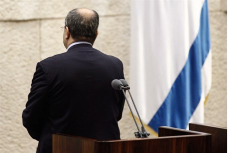 MK Tibi stands with back to Knesset