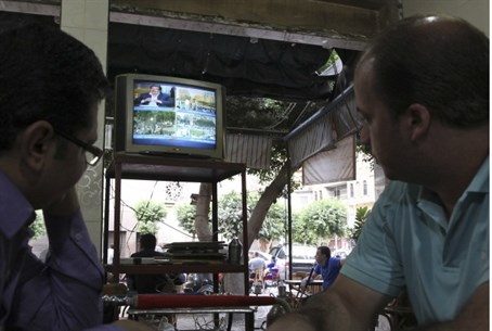 Watching the news in Cairo