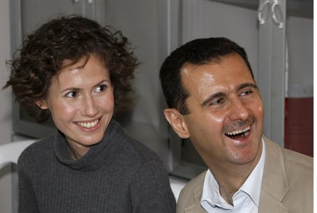 Happier times: Asma al-Assad with her husband
