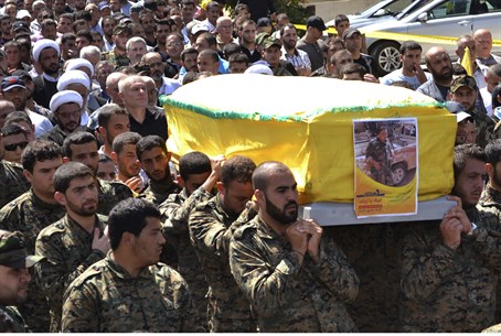Hezbollah terrorists carry coffin of operativ