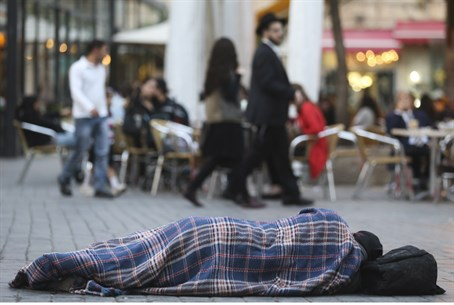 Man sleeps on sidewalk in Jerusalem