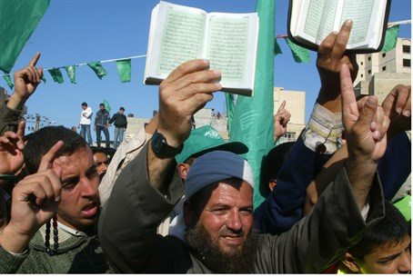 Hamas supporters hold copies of the Koran dur
