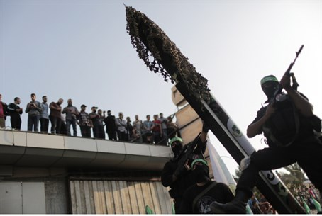 Hamas terrorists parade rockets
