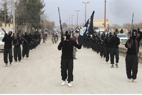 ISIS fighters parade in the northern Syrian c