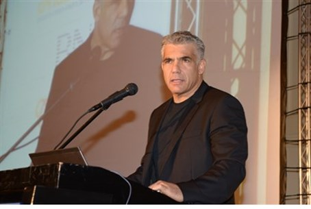 Lapid addresses business owners