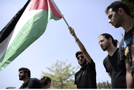 Arab and leftist students wave PLO flag at TA