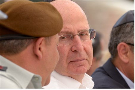 Yaalon (R) speaks to officers during Memorial