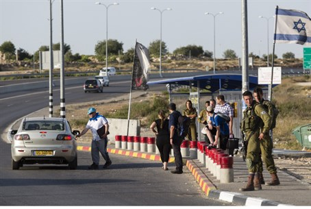 IDF soldiers guard hitchhiking posts followin