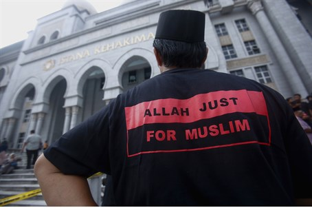 Muslim activist stands outside Malaysia court