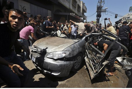 Remains of a car hit by IAF airstrike in Gaza
