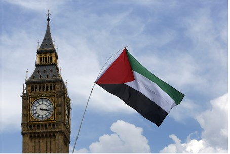 Anti-Israel protesters fly PLO flag at London