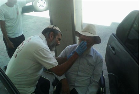 Rabbi Levinger receives first aid treatment