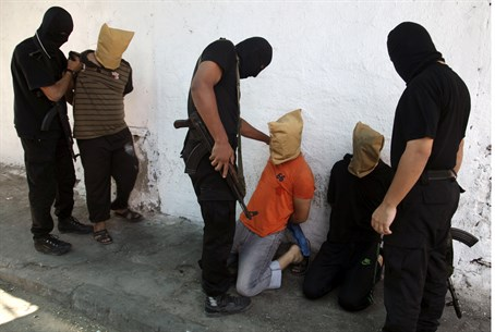 Hamas gunmen prepare three men for execution