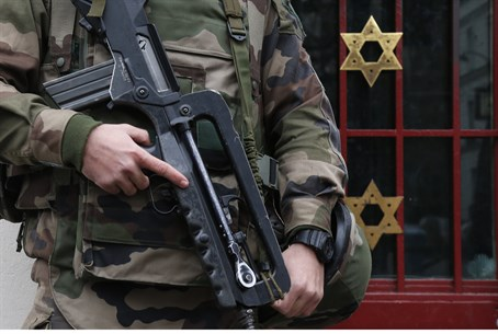 French soldiers guard a Jewish institution in western Paris.