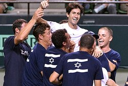 Amir Weintraub (C) of Israel celebrates with teammates