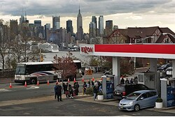 people stand in line for gas after Hurricane Sandy