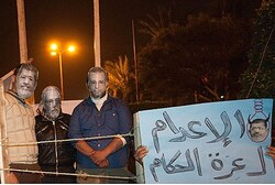 Protesters wear masks of Morsi and other Egyptian leaders