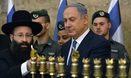 Netanyahu lights first Hanukkah candle with Border Police personnel